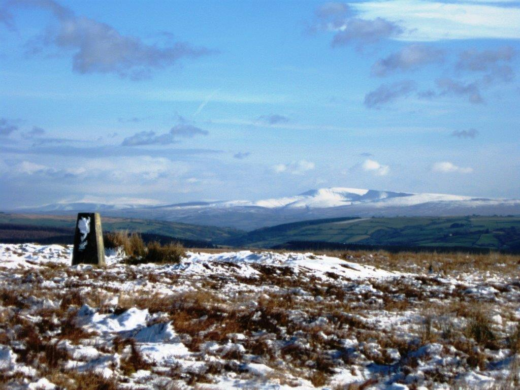 Llanllwni mountain with Brecon Beacons in the distance